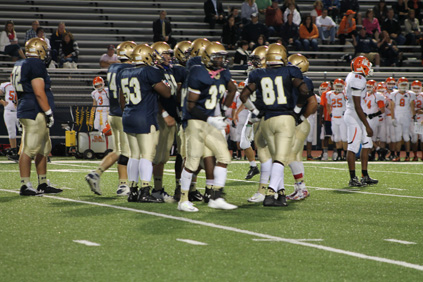 Malden football players congratulating each other after a good play.