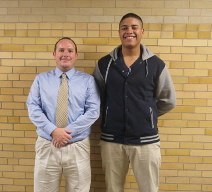 Coach Smith and senior Martiz Ortiz posing for a picture. Photo taken by Cassandra Reyes.