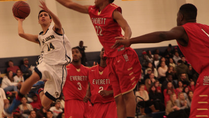 Junior Jorge Salgado drives into the paint against Everett