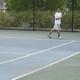 Senior Eugine Szeto on the tennis court.