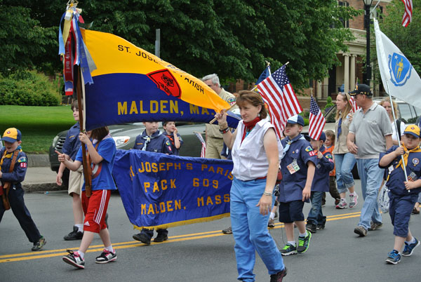 Boy Scout Troop 603 marching down in the parade. Photo by Ashley Leung.