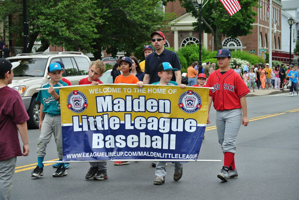 Malden's Little League Baseball team marching in the parade.