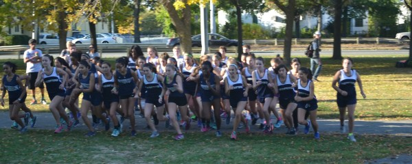 The girls cross country team staring out their meet against Somerville. Photo by Abhishek Rana.