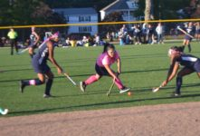 Sophomore Queenie Dang keeping ball away from opponent.