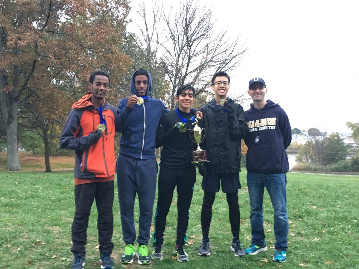 Ameen Anwar, far left, with his fellow teammates and coach David Londino. Photo submitted by Ameen Anwar.