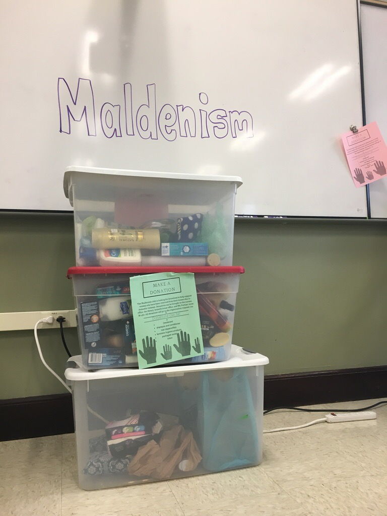 Bins of donated items for Respond Inc. by Maldenism Club. Photo by Rebecca Pereira.